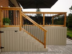 Elevated patio deck with storage under the stairs.
