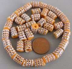 small yellow painted glass beads for your self made jewelry.