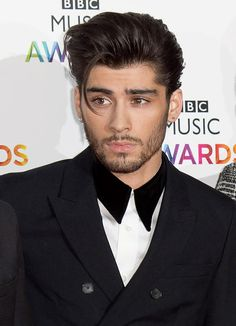 14 Zayn Malik Hair Moments That Predicted His Defection From One Direction : 11. Slicked back