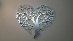 Tree of Life This is a limited edition custom laser cut aluminum decorative panel in a contemporary design. Inspired by the Tree of Life design, its simplicity and elegance will compliment your space. This forms an excellent focal point of any room. It can be installed tight to a wall or