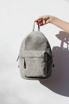 A classic backpack in the softest leather. Outer zip pocket. Adjustable backpack straps. Interior sleeve pocket fits an iPad Mini or small book, interior zip pocket fits a phone or small daily essenti