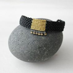 Black and gold wide macrame bracelet. A minimal, geometric design with classic colors to adorn your wrist all day round! Casual, rock, formal or beachwear, whatever the dress code is you can wear it with no second thoughts. And dont forget Christmas is around the corner, it would be a