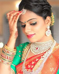 South Indian bride. Diamond Indian bridal jewelry.Temple jewelry. Jhumkis. Red silk kanchipuram sari with contrast green blouse.Braid with fresh jasmine flowers. Tamil bride. Telugu bride. Kannada bride. Hindu bride. Malayalee bride.Kerala bride.South Indian wedding.