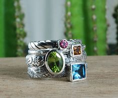 Never been a huge fan of mother's ring with birthstones...but this stackable version I LOVE.  I love the uniqueness of different bands, shape birthstones, etc.