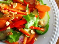 This is a spicy, refreshing salad thats perfect served on a hot summer evening with garden-fresh veggies. Its easiest to use a mandoline to slice the veggies, but a sharp knife and patience will do quite well, also!
