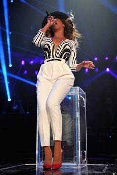 Beyoncé in the second bespoke Gucci outfit of beaded top and silk trousers. The singer will unveil more Gucci costumes during the Latin American leg of her tour, which stars on September 8 in Brazil.