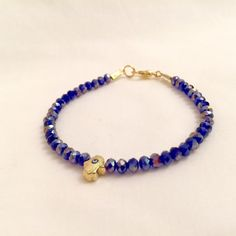 A personal favorite from my Etsy shop https://www.etsy.com/listing/253552480/blue-crystal-bracelet-evil-eye-hamsa
