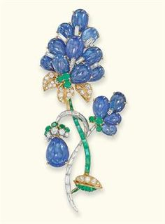 A SAPPHIRE, DIAMOND AND EMERALD BROOCH, BY MAUBOUSSIN