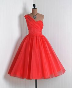 Coral, 50's, sweetheart, and a bow? Yes, please!