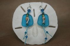 Caribbean blue seaglass earrings accented with tiger nassa shell , Swarovski crystals, seed beads, and sterling silver earwire.