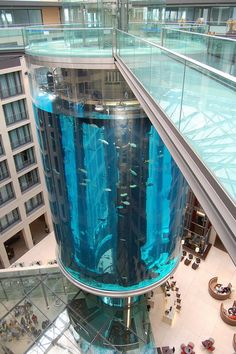 Här var jag och mannen och tog en drink i baren The AquaDom in Berlin, Germany, is a 25 metre tall cylindrical acrylic glass aquarium with built-in transparent elevator. This is a nice place in Berlin to take a drink an look at this huge aquarium. Places Around The World, Oh The Places You'll Go, Places To Travel, Travel Sights, Travel Destinations, Amazing Buildings, Amazing Architecture, Famous Buildings, Ancient Architecture