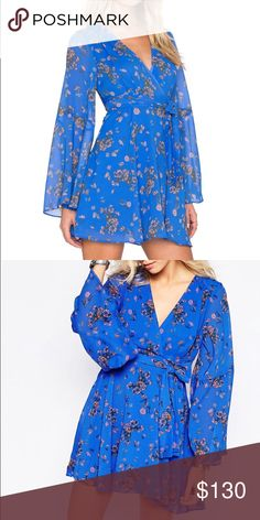 NWT Free People dress New with tag! Gorgeous blue Free People flowy dress.  Sold out in stores and online. Bell sleeves, side zipper, removable fabric belt. 25% off bundles of 2+ Free People Dresses Mini