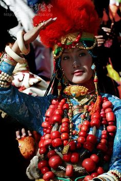 Woman from Litang wears her family's ornaments at the 5th Khampa festival festival in Yushu, 2007, Kham, Tibet