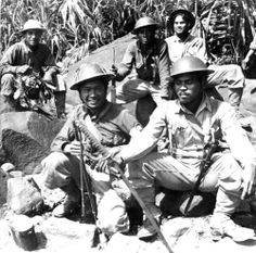 Filipino partisans show off their collection of captured Japanese souvenirs on the Bataan Peninsula during the Battle of Bataan. Shortly after the Japanese Army invaded the Philippines in December. Military Units, Military History, Military Uniforms, O Donnell, Palawan, Manila, Bataan Death March, Leyte, Imperial Army