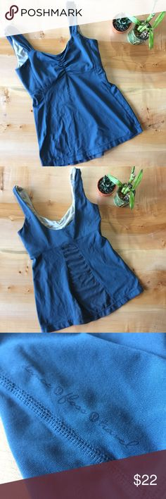 Lululemon Tank This tank is in great condition! It's an older style but it's in excellent condition! Size 4. Smoke and pet free home. No pads. No trades lululemon athletica Tops Tank Tops