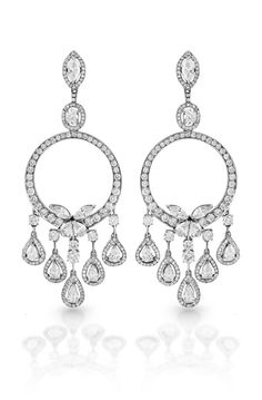 The ultimate diamond chandelier earring, for the most discerning women in the world. Crafted from white gold and featuring almost 15 carats of round, pear, oval and marquis shaped diamonds, you can pair with our vintage style diamond bracelets and your jaw dropping look will be complete.