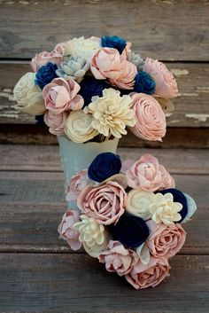 Sola flower bouquet, wedding flowers Beautifully natural sola wood flower bouquet hand dyed in shades of navy blue, blush pink and just a few gray. This bouquet is full of a variety of sola blooms creating so much texture and uniqueness. Some of the stems are wire, and some are natural stems to create an overall natural look, yet allow for a better design. The stems then are wrapped together with twine and finished off with a creamy double satin bow. Last photo is to show stem detail, not…
