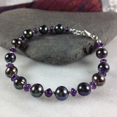 Silver ,peacock pearl and amethyst bracelet £38.00