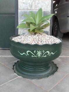 Transformando pneus em vasos de planta.....