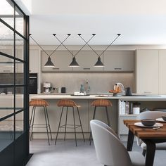 Add warm tones to your modern kitchen using a mixture of warm grey colours and a large kitchen island. Pictured Sutton in Highland Stone and Farringdon Grey by Sigma 3 Kitchens. Kitchen Display, Kitchen Store, Kitchen Styling, Home Kitchens, Modern Kitchens, Large Kitchen Island, Kitchen Views, Kitchen Collection, Modern Kitchen Design