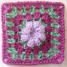 Add some texture to your granny square afghan by inserting a few of these 3D Crochet Flower Granny Squares in the mix.