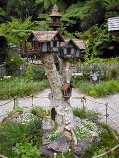 Bird Condos on an old tree stump