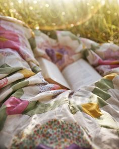 Quilt on the grass and a book ... heaven.