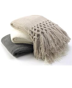 Gorgeous throws in cream, charcoal and oatmeal - made of soft alpaca wool.