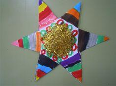 Estrella amb retoladors i purpurina per arbre gran.