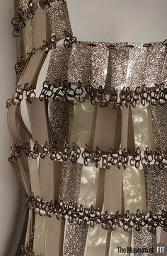 Paco Rabanne 1968 , he experimented with new and unusual fabrics and developed an early interest in none woven materials.  Museum at FIT New York.
