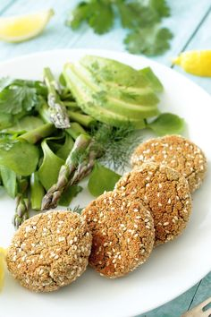 Vegan mini herbed tofu burgers with asparagus, avocado and watercress salad make a delicious light lunch.