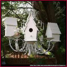 Dollar Store Crafter: Turn Birdhouses And A Chandelier Into A Bird Condo... ~ take chandelier from old house, paint it & cap wires of some of the arms, then put painted bird houses on those arms, hand in place of light fixture