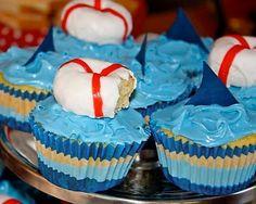 Shark party cupcakes -  love the mini donut!