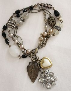 This would go with any colors..... intricate and SO beautiful.... ♡ http://www.andreasingarella.com/images/large/brac13.jpg