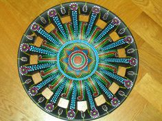 Happy hubcap Art, recycled art