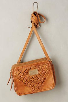 WE ♥ THIS!  ----------------------------- Original Pin Caption: Button Braid Crossbody Bag - #anthrofave