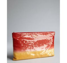 OMG!  This looks like a beautiful sunset!                  Prada red and orange ombre sequined oversized zip clutch $1,175
