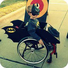 bat mobile wheelchair costume!!! (p.s. there are flames coming out the back!)