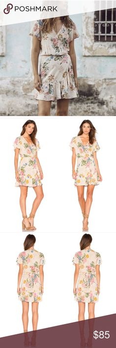 NWT Auguste Delilah Frills Mini Wrap NWT Delilah Bloom Wrap Mini Dress in Delilah Bloom Natural! I'm in love with Auguste's Wrap dresses and I love this one too! Only selling because I have this in black and have other natural/Floral minis. ❤️                                                                         Size is AUS 8, fits a US 4/S. Auguste the Label Dresses Mini