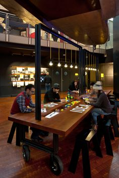 Communal Seating and Showcase space in background.  Bezos Center for Innovation,© Lara Swimmer