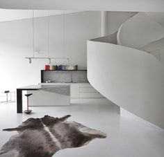Walls sinuously move and bend through this loft apartment interior housed in a former butter factory, in West Melbourne. A sculptural stair sits at the converging point in the space, twisting, and soaring up towards a recreational roof terrace which...