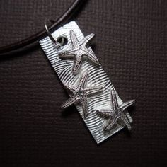 Starfish and; waves fine silver pendant on leather cord - handmade