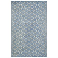 Classic style receives a modern twist with the Chatham area rug's transitional design. An abstract diamond pattern in blue and gray wool delivers interiors plush geometric appeal.  •Tufted wool •Blue and gray 640