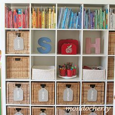 Love how Joy from MondoCherry has organised her playroom's Expedit bookshelf. Adore the tags!