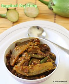 In Udupi this eggplant dry curry is cooked in a very simple and quick way. The eggplants are sliced lengthwise and cooked in coconut oil seasoning without any water.