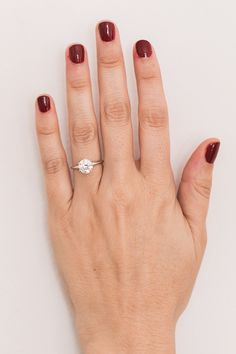 Solitaire diamond ring   holiday red mani