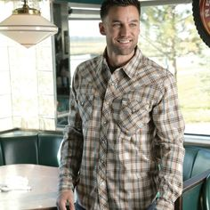 A pearl snap shirt should be traditional, bring a sense of devotion to one's soul. This cream plaid shirt does just that. It brings to mind the days of carefree nights by the campfire with the dark brown and burning red stripes crossing over one another.   STW8095000 CRE