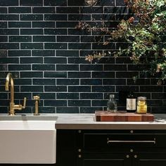 Anyone feeling the need to move along from their beloved white subway tiles and towards something a little more dramatic?
