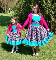 "2015 My daughter and I wearing our Chilean ""China"" dresses"