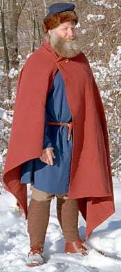 The cloak was simply a large rectangular piece of wool, sometimes lined with contrasting color wool. Cloaks provided protection from the cold, from the wind, and to a limited degree, from the rain. Some cloaks were made with very dense, very thick wool, which would have provided extra protection. Cloaks were typically worn offset, with the right arm (the weapon arm) unencumbered by the cloak. Cloaks could be embroidered, or trimmed with tablet woven braid. Typically they hung to somewhere…
